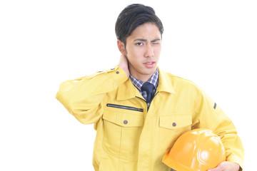 疲れた表情の労働者