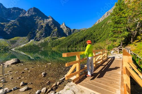 Woman tourist at Morskie Oko lake in summer, Tatra Mountains - 80282961