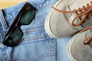 jeans sneakers and sunglasses