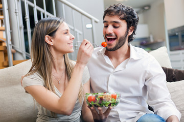 Couple eating a salad