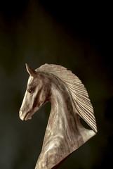 Wooden horse black background