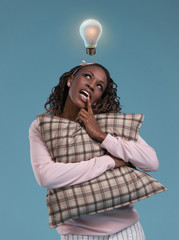 Lady standing and thinking with light bulb overhead