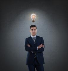 Business man with idea light bulb above head