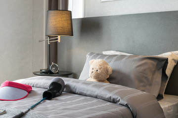 kids room with doll bear and pillows on bed at home