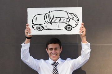 Business man with new car sign