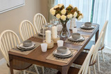 dining table and comfortable chairs in modern home with elegant