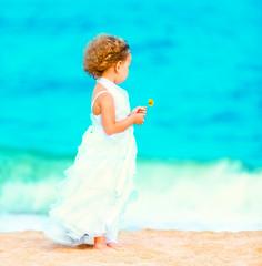 Little girl in wedding dress.