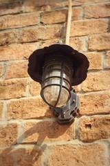 Old lamp brown brick wall.