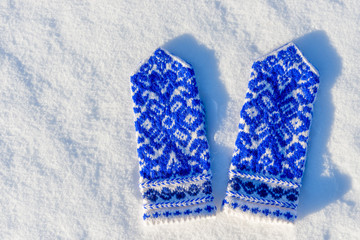 mittens with beautiful pattern on the snow