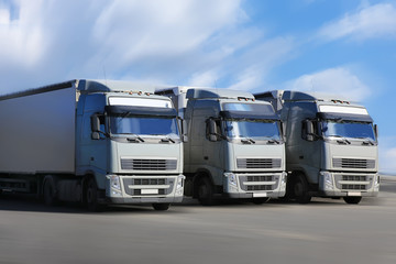 three trucks go on  highway