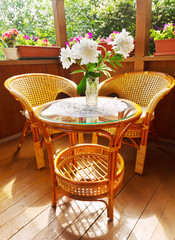 wooden terrace with chairs and table