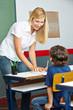Teacher helping elementary school student