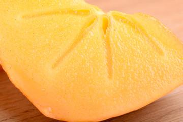 sharon kakis sliced - japanese persimmons close up