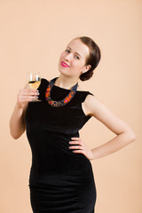 beautiful young brunette woman holding a glass of white wine