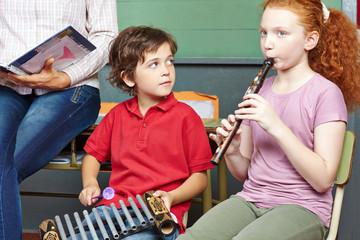 Children having music lessons in school
