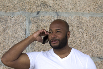black man talking on the phone in the street