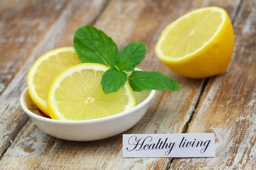 Healthy living card with lemon and mint leaves
