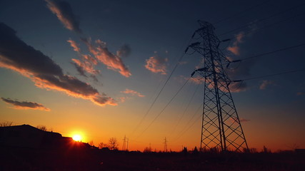 Electric Pylon and Power line in sunset, Time Lapse