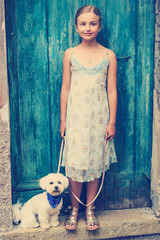 Lovely fashion girl with maltese dog