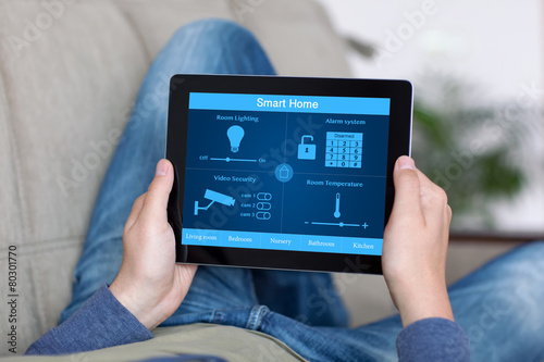 man holding tablet with program smart home on the screen - 80301770