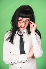 young woman in office dress with glasses on green background