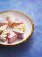 close up plate of marshmallow on the blue color background