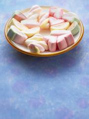 plate of marshmallow on the blue color background