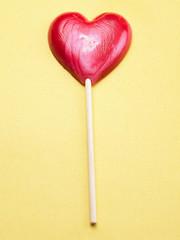 heart shape lollipop on the color background