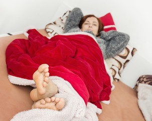 Caucasian sick woman lying in the bed