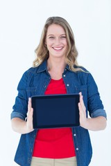 Smiling woman holding tablet pc