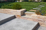 Fototapety natural stone stairs in a beautiful home garden