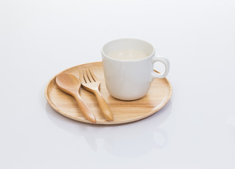 Cup of soy milk with wood plate isolated on white background