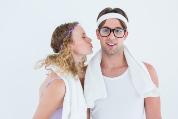 Geeky hipster kissing her boyfriend