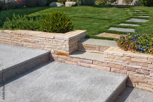 Fotobehang Tuin natural stone stairs in a beautiful home garden