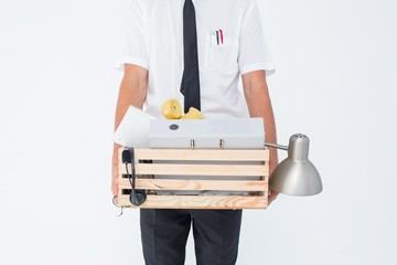 Fired businessman holding box of belongings