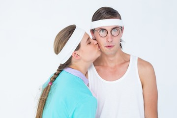 Geeky hipster kissing her boyfriend