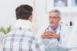 Doctor talking to patient wearing neck brace