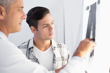 Doctor showing X rays to his patient