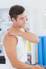 Young man suffering from shoulder pain