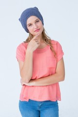 Hipster woman with hat looking at camera