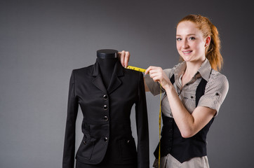 Woman tailor working on new dress