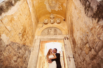 groom and bride hugging in a hallway