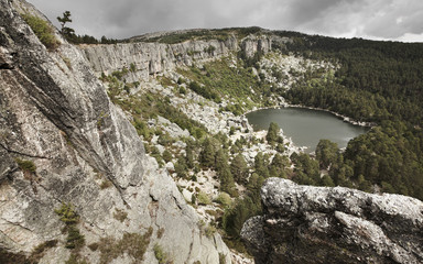 Landscape with lake and pine forest in Spain. Laguna Negra