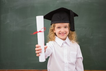 Pupil with graduation hat and holding her diploma
