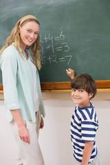 Teacher explaining mathematics to a pupil