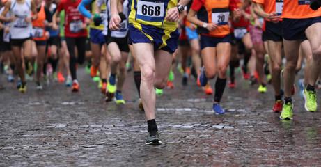 runners during marathon while it is raining
