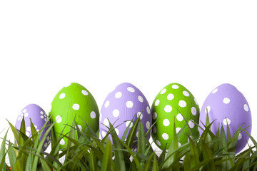 Row of Easter eggs in Fresh Green Grass