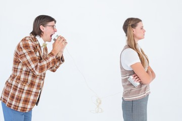 Geeky hipsters using string phone