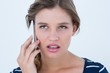 Unsmiling woman calling with her smartphone