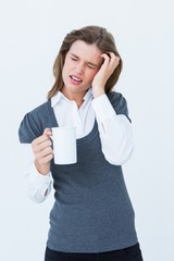 Woman with headache holding mug